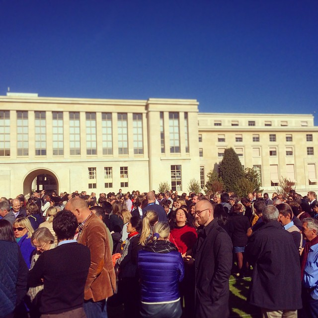 United Nations staff convening on the lawn inside the UN…