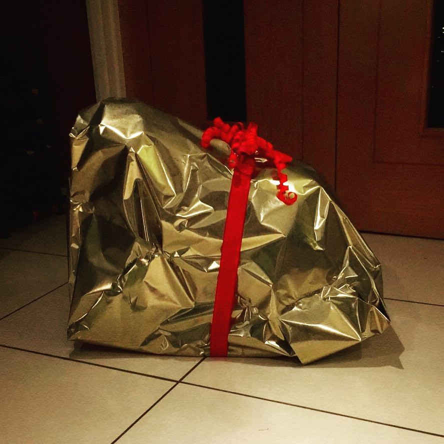 My attempt at gift wrapping a childs rocking horse hellip